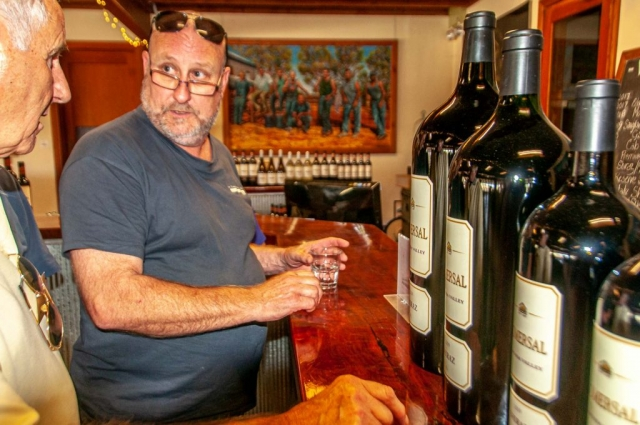 Selecting a bottle at Gomersal Wines